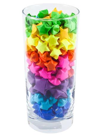 rainbow cocktail: Stelle multicolore in un bicchiere Archivio Fotografico