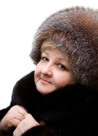 Beautiful woman wearing in fur hat and in fur coat photo