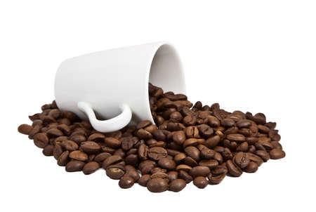 Coffee grains in a white cup and disseminated about a coffee pot on a isolated background photo