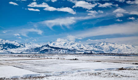Panoramic landscape of snowy mountains in the spring