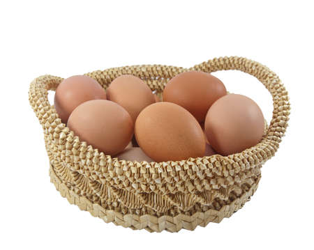 Easter eggs in brown basket on a white background Stock Photo - 9140060