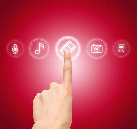 Hand choosing slide film symbol from media icons
