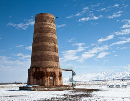Ancient Kyrgyz Burana tower in the mountains