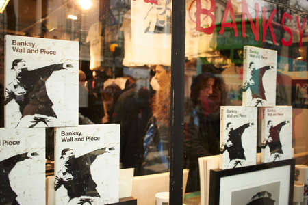 Woman looking at the window at Unofficial Banksy Store in Notting hill Editöryel