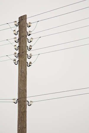 insulators: Photo of wooden power poles with wires and insulators