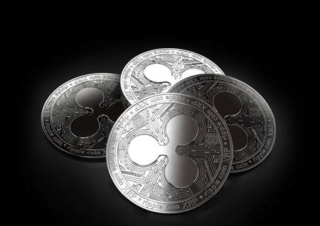 Stack of four silver Ripple coins laying on the black background. 3D rendering