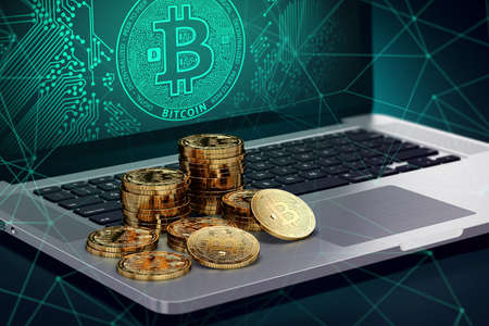 Laptop with Bitcoin symbol on-screen and piles of golden Bitcoin. Blockchain transfers concept. 3D rendering