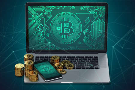 Laptop and smartphone with Bitcoin symbol on-screen and piles of golden Bitcoin. Bitcoin transfer concept. 3D rendering Stock Photo
