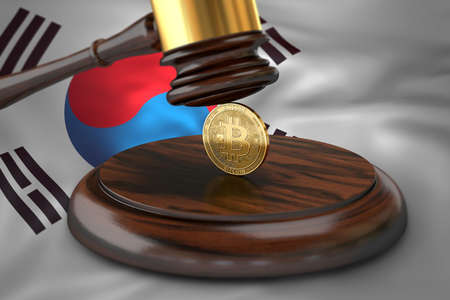 Bitcoin and judge gavel laying on flag of South Korea. Bitcoin legal situation in South Korea concept. 3D rendering Imagens