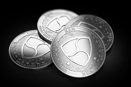 Stack of four silver NEM coins laying on the black background. 3D rendering