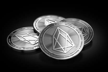 Stack of four silver EOS coins laying on the black background. 3D rendering Stock Photo