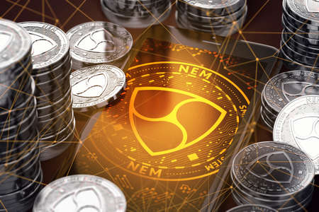 Smartphone with orange NEM symbol on-screen among silver NEM coins. NEM concept coin & virtual wallet. 3D rendering Reklamní fotografie
