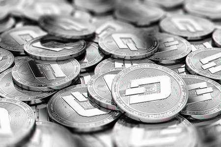Stack of silver Dash coins in blurry closeup with copy space above in blurred area. 3D rendering