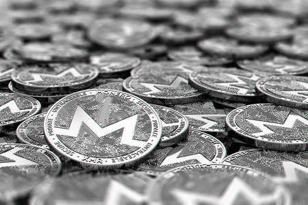 Stack of silver Monero coins in blurry closeup with copy space above in blurred area. 3D rendering