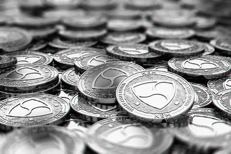 Stack of silver NEM coins in blurry closeup with copy space above in blurred area. 3D rendering 스톡 콘텐츠
