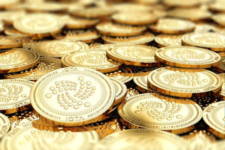 Stack of golden IOTA coins in blurry closeup with copy space above in blurred area. 3D rendering Stock Photo