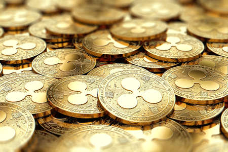 Stack of golden Ripple XRP coins in blurry closeup with copy space above in blurred area. 3D rendering