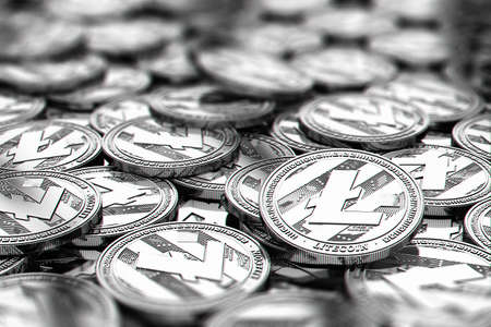 Stack of silver Litecoin coins in blurry closeup with copy space above in blurred area. 3D rendering