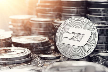 Silver Dash coin in closeup shot. Bright sun flare as a sign of prosperity. 3D rendering Stock Photo