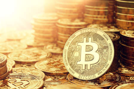 Golden Bitcoin coins closeup and copy space on the left. 3D rendering