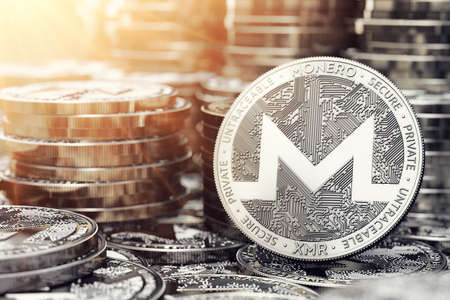 Monero coin in closeup shot. Bright sun flare as a sign of growth. 3D rendering Reklamní fotografie - 92534566