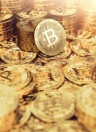 Piles of Golden Bitcoin coins closeup and copy space below. 3D rendering