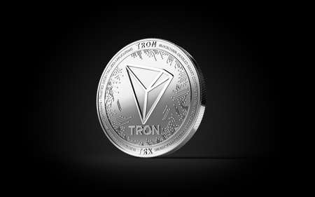 Silver TRON cryptocurrency physical concept coin isolated on black background. 3D rendering