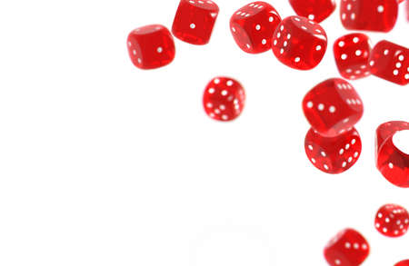 Red game dices isolated on white background and copy space on the left