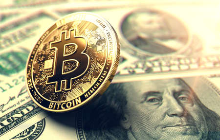 Bitcoin coin on American Dollar bills. Bitcoin in the center of attention in United States concept. 3D rendering Stock Photo