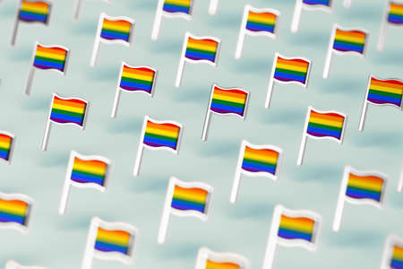 Blurry close-up focus on Rainbow LGBTQ flags pattern. June the gay pride month symbol concept. Isolated on pastel green background. 3D rendering Imagens