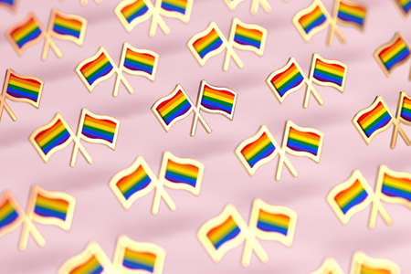 Shallow DOF focus on Rainbow LGBTQ flags pattern. Gay pride month symbol concept. Isolated on pastel pink background. 3D rendering