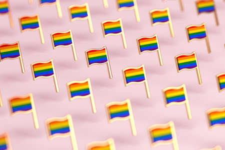 Blurry close-up focus on Rainbow LGBTQ flags pattern. June the gay pride month symbol concept. Isolated on pastel pink background. 3D rendering
