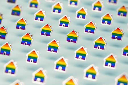 Blurry closeup shot on group of gay pride rainbow in a home shape isolated on pastel green background. LGBTQ people rights to live together concept. 3D rendering