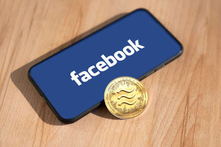 WROCLAW, POLAND - JUNE 19th, 2019: Facebook announces Libra cryptocurrency. Libra coin concept. - Image Imagens - 128213822