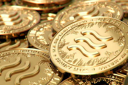 Stack of golden Libra cryptocurrency concept coins in blurry closeup. 3D rendering