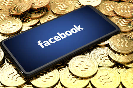 WROCLAW, POLAND - JUNE 20th, 2019: Facebook announces Libra cryptocurrency. Smartphone with facebook logo on the screen is laying down on Libra concept coins - 3D Illustration