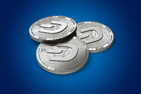 Stack of three silver Dash coins with 2019 logo update, isolated on blue background. 3D rendering