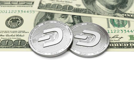 Two Dash coins (with 2019 updated logo) laying on dollar bills with copy space below. Desirable cryptocurrencies concept. 3D rendering Imagens