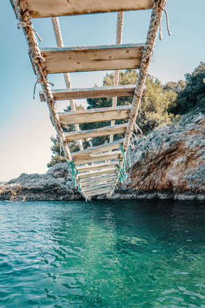 Under the rope bridge over a cliff in Punta Christo, Pula, Croatia - Europe. Travel photography, perfect for magazines and travel destination articles.
