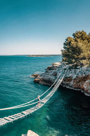 Above the rope bridge over a cliff in Punta Christo, Pula, Croatia - Europe. Travel photography, perfect for magazines and travel destination articles.