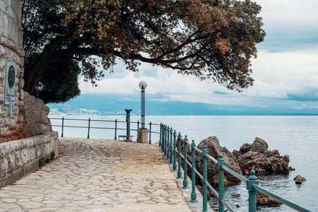 Stone path along the shore in Opatija, Croatia, Europe. No people. Holiday travel destinations around Europe.