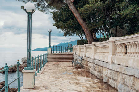 Stone path along the shore in Opatija, Croatia, Europe. No people. Holiday travel destinations around Europe. Reklamní fotografie - 132560916