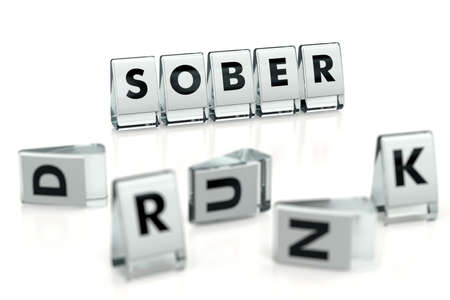 SOBER word written on glossy blocks and fallen over blurry blocks with DRUNK letters. Isolated on white. Importance of sobriety - concept for articles, magazines, blogs. 3D rendering