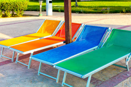 lounges: Chaise lounges in swimming pool colorful in swimming pool Stock Photo