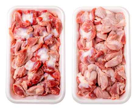 gizzard: Raw frozen chicken gizzard in plastic plate