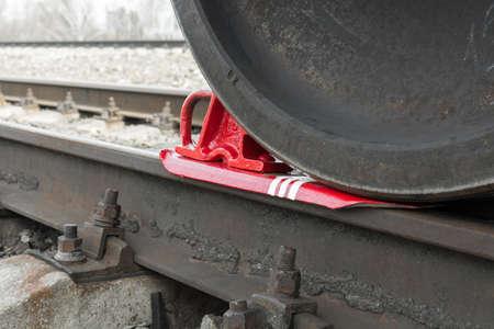 inhibit: Train shoe propped wheel train. Train shoe propped wheel train.