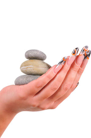beautiful female nails with pebbles