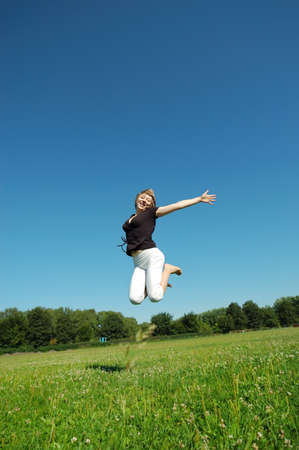 Jumping young happy girl  Stock Photo - 13258022