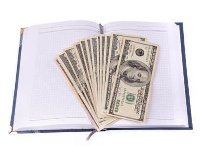 opened notebook with dollars banknotes Stock Photo - 7250183
