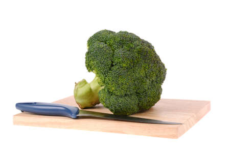 broccoli with knife on cutting board isolated Stock Photo - 10107309